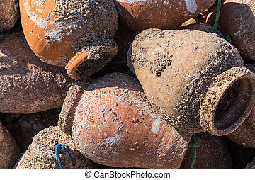 Portugal - Pots for catching octopus - Clay pots used to...