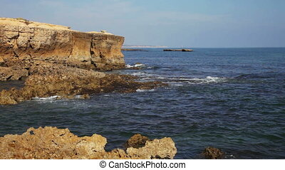 Portugal, waves of the Atlantic Ocean break about coastal rocks