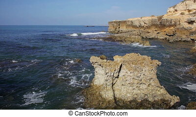 Portugal, waves of the Atlantic Ocean break about coastal...