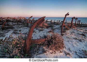 Portuguese beach cemetery anchors. Barril.