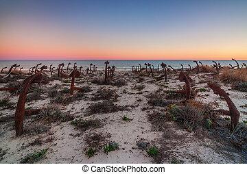 Portuguese beach Tavira, cemetery anchors. Sunset.
