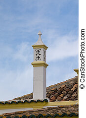 Portuguese chimney on a brown tile roof