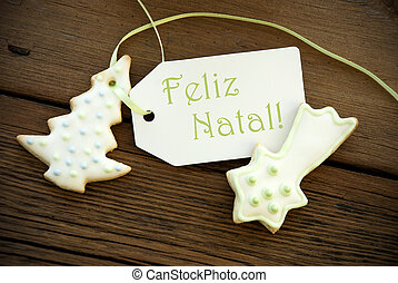 The Portuguese Words Feliz Natal, which means Merry Christmas, on a Label with Christmas Cookies