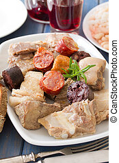 portuguese dish with red wine on blue wooden background
