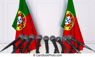 Portuguese official press conference. Flags of Portugal and...