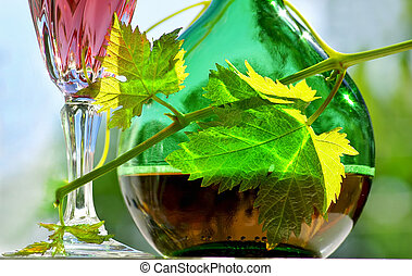 Portuguese rose wine. - Portuguese rose wine and green leaf.