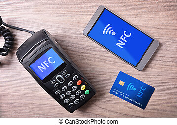 POS card and mobile on wood table nfc transmision system -...