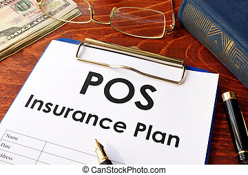 POS Insurance Plan on a table.