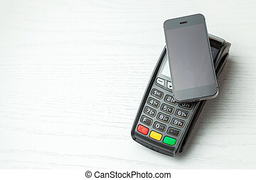 POS terminal, Payment Machine with mobile phone on white background. Contactless payment with NFC technology.