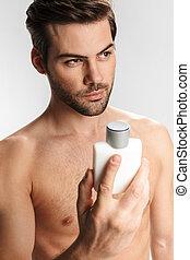 posar, homem, foto, bonito, mostrando, perfume, metade-...