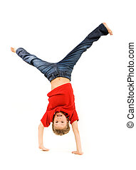 Playful lad standing on his arms with legs pointing upwards over white background