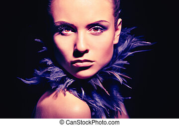 Image of gorgeous woman looking at camera on black background
