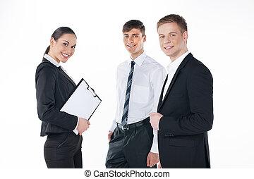 posición, empresarios, aislado, joven, tres, juntos., equipo, blanco
