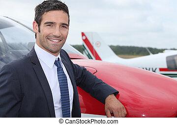 posición, frente, avión, joven, hombre de negocios