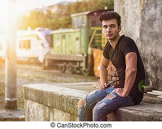 posiedzenie, młody, konkretny, uśmiechanie się, steps., człowiek