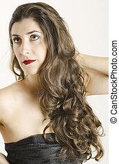 Posin Spanish woman - Brown haired girl posing in studio...