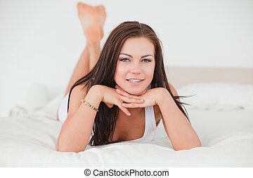 Posing dark-haired young woman