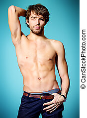 posing man - Handsome shirtless young man posing at studio.