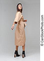 Posing model in a cloak