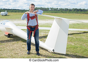 posing next to the glider
