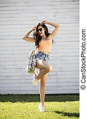 Pretty brunette girl with long hair posing