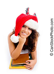 posing student wearing christmas hat