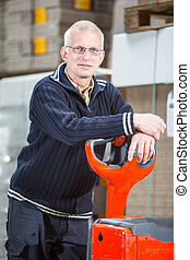 Posing with a pallet truck