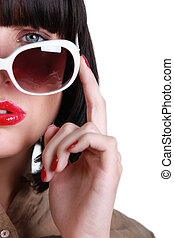 Posing woman with sunglasses