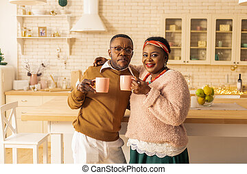 Positive Afro american couple looking at you