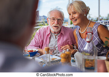 Positive aged people having a meeting in the restaurant