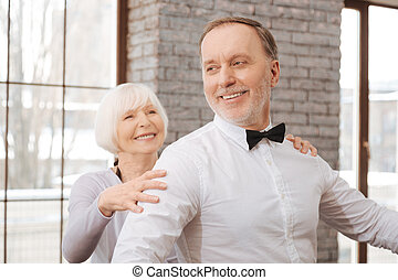 Positive aging dance couple performing in the dance studio