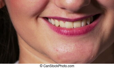 Positive and negative emotions described by woman mouth close up