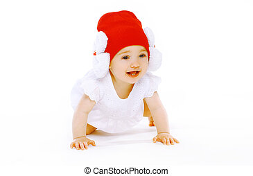 Positive baby in red hat crawls