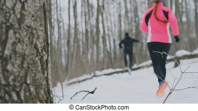 Positive beautiful young healthy couple running with...