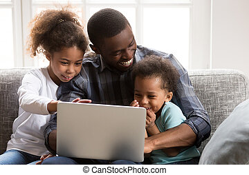 Positive black African family together at home