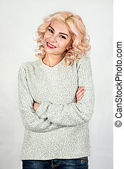 Positive blond in a knitted sweater