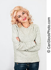 blond in a knitted sweater