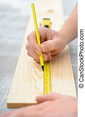 Positive boy holding tape measure - Be precise. Close up of...