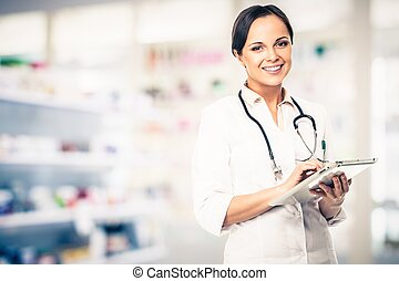 Positive brunette doctor woman in drug store with tablet pc