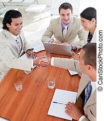 Positive Business associates closing a deal