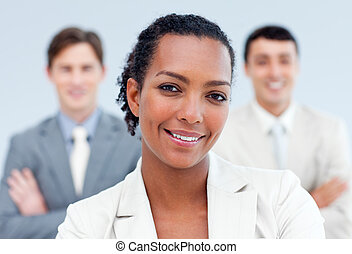 Positive business partners standing with folded arms