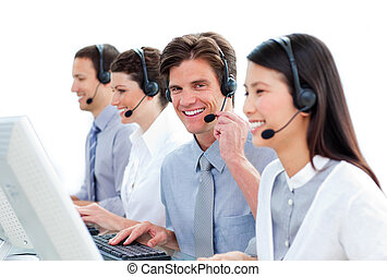 Positive business people in a call center - Positive...