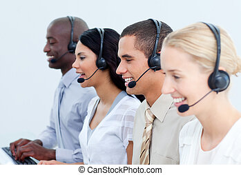 Positive business people working in a call center