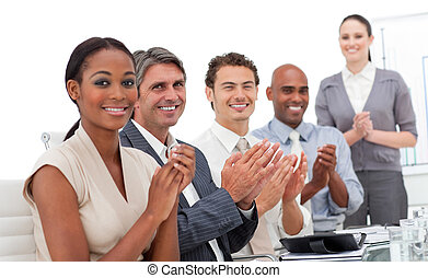 Positive business team applauding a good presentation