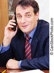 Positive businessman on phone