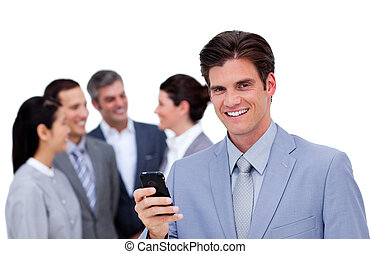 Positive businessman standing in front of his team