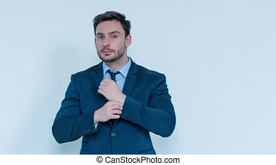Positive businessman standing on white background