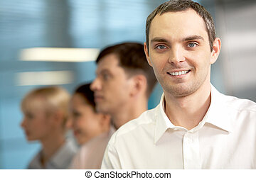 Positive businessman - A businessman looking at camera and...