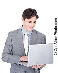 Positive businessman using a laptop