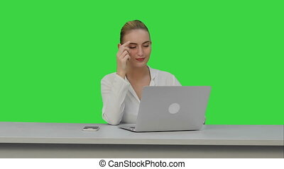 Positive businesswoman ready to work on laptop computer at the begining of day on a Green Screen, Chroma Key.